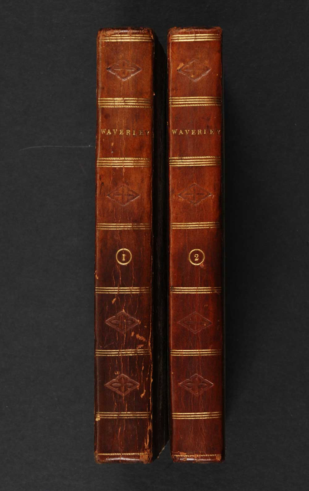 [Sir Walter Scott]. <em>Waverley, or, 'Tis sixty years since.</em> [1st edition]. Edinburgh: Printed by James Ballantyne and Co. for Archibald Constable and Co., Edinburgh; and Longman, Hurst, Rees, Orme, and Brown, London, 1814. Three volumes; Vol. 1, 2 displayed.