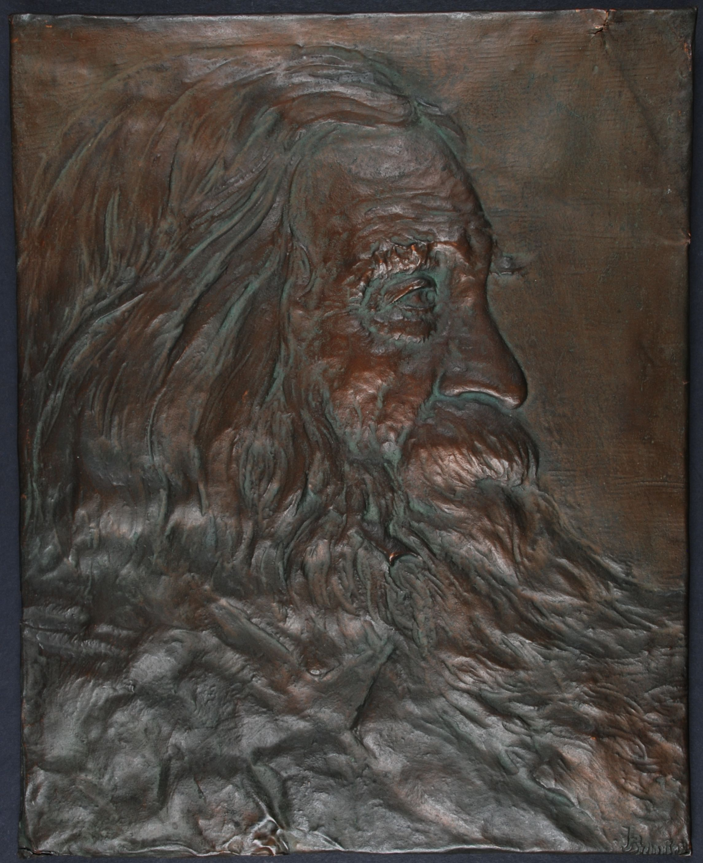 Copper relief profile image of Walt Whitman by unknown artist, ca. 1912.