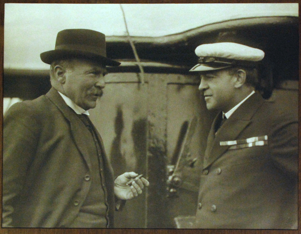 "Photograph (framed). 'Dr Robert McNab and Sir Ernest Shackleton. Departure of the ""Aurora"" for Ross Sea on her Relief Expedition, December 20th 1916'."